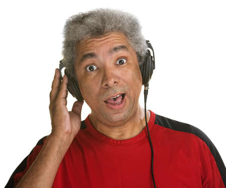 Excited middle aged man holding pair of headphones photo