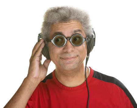 anticipating: Interested mature male with sunglasses and headphones