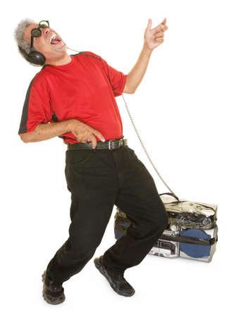 air guitar: Happy man with big tape deck playing air guitar