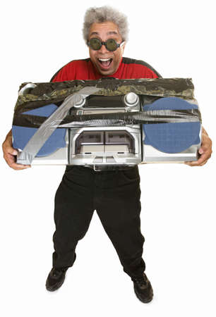 hysterical: Giddy middle aged man carrying taped boom box Stock Photo