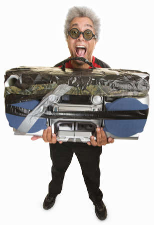 boom box: Handsome African man in sunglasses holding large tape deck Stock Photo