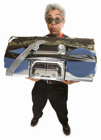 Man having difficulty carrying large 1980s portable radio photo