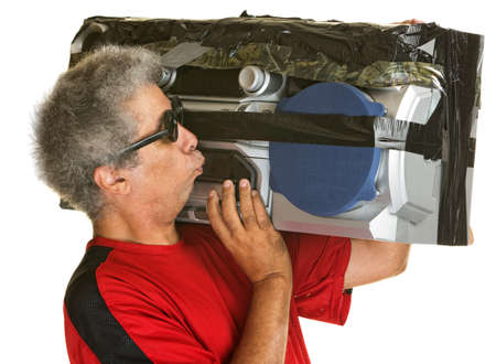 boom box: Mature man kissing large portable radio over isolated background Stock Photo