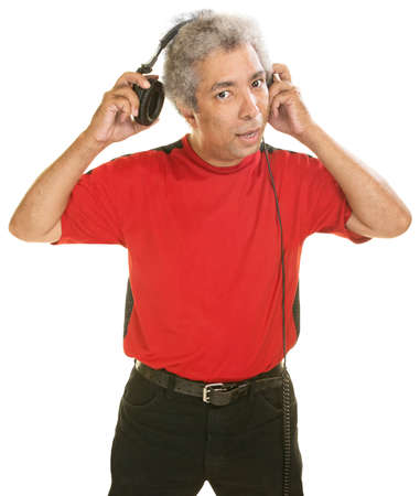 cut off head: Middle aged Hispanic man removing large headphones