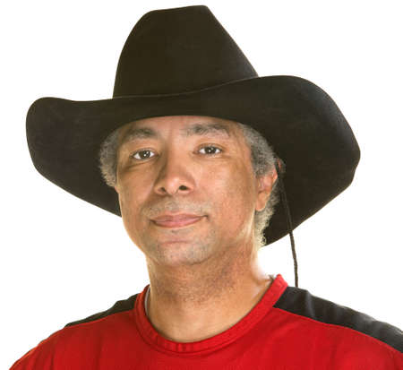 Calm middle aged man with cowboy hat photo