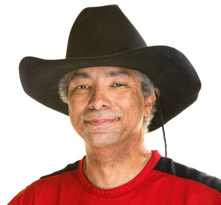 Cheerful handsome man in cowboy hat on white background photo