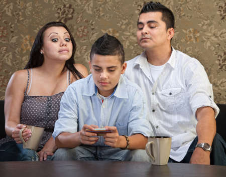 Nosey parents behind teenage son sending text messages photo