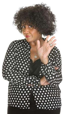 Beledigd rijpe dame in polka dot op een witte achtergrond Stockfoto