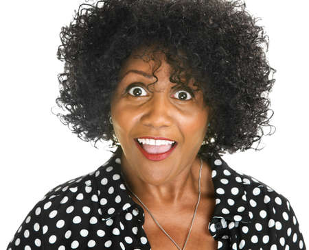 Amazed middle aged African woman on isolated background
