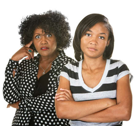 disrespectful: Black mother with teenage daughter on isolated background