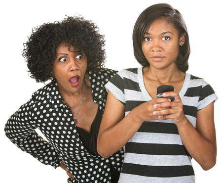 nosey: Shocked mother with teenage daughter texting on phone