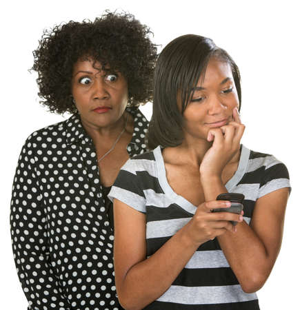 nosey: Overprotective mother with teenage daughter reading text messages