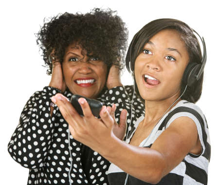 Woman covering her ears while young person sings photo