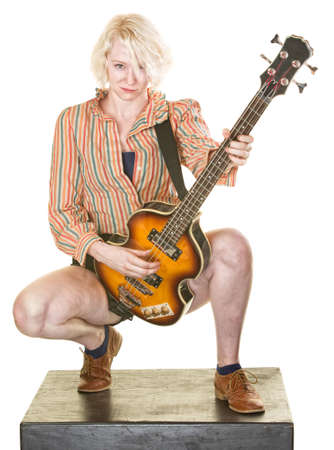 Grinning female guitar player on isolated background photo