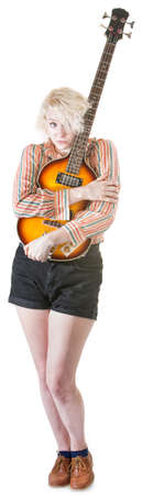 timid: Timid young European female hugging a guitar