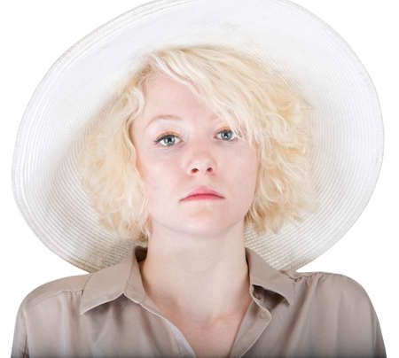 Close up of serious white woman in big hat photo
