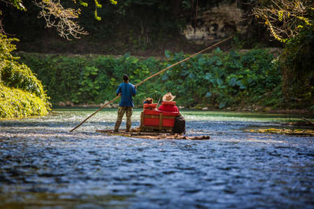 martha: River Boat with tourists on Martha Brae River in Jamaica Stock Photo