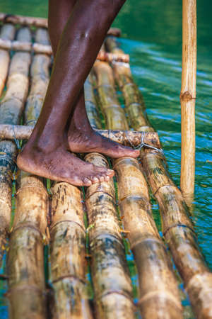 martha: Feet of River Boat and Captain on Martha Brae River in Jamaica