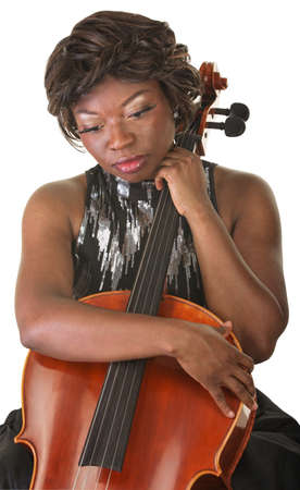 Sad African woman holding cello and looking down photo
