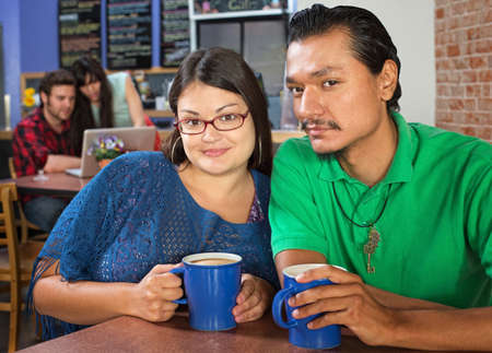 Young couple sitting in a coffee house photo