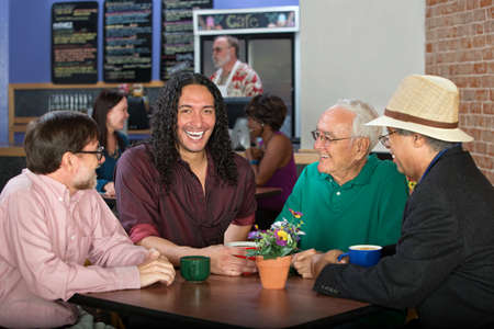 Men from various ethnic groups and ages in cafe photo