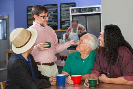 Group of adults in restaurant talking to each other photo