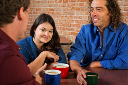 Pretty Latino woman with Caucasian friends in cafe photo