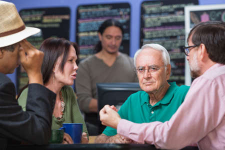 Frowning man with concerned friends in coffee house Stock Photo - 22683766