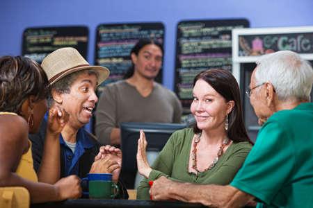disrespectful: Woman gesturing man in cafe to stop talking