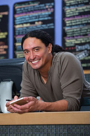 native american man: Handsome Native American restaurant owner at counter