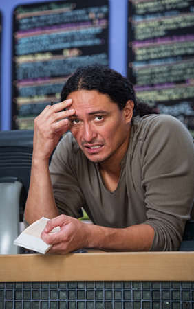 Stressed out Native American restaurant owner at counter
