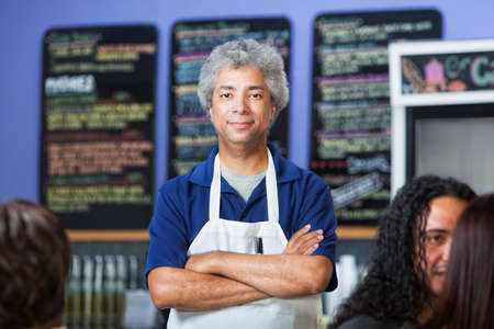 proprietor: Man with folded arms standing in a coffee house Stock Photo