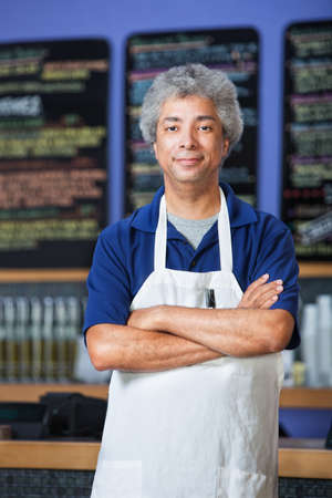 capable: Confident mature Black cafe owner in apron  Stock Photo