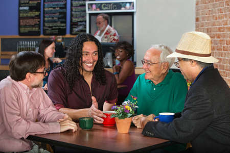 Mixed group of four adult men in cafe photo