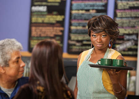 proprietor: Pretty woman with grin serving coffee to customers