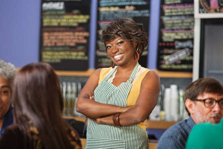 Confident African woman working at a coffee house photo