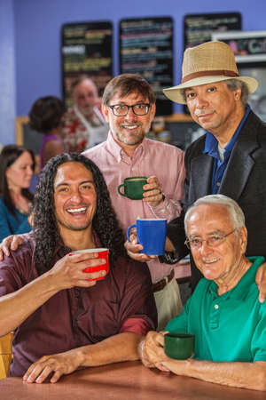 mature mexican: Diverse group of handsome men in coffee house Stock Photo
