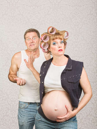 trashy: Frustrated man with annoyed pregnant hillbilly woman