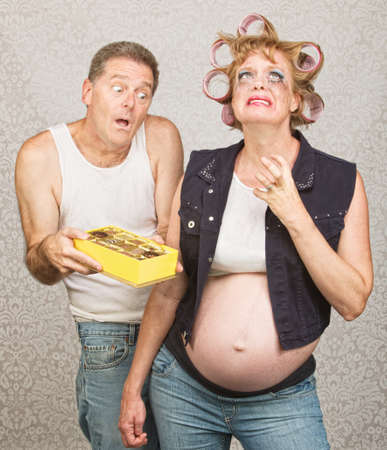 Moody redneck hillbilly pregnant couple with candy Stock Photo - 23050422