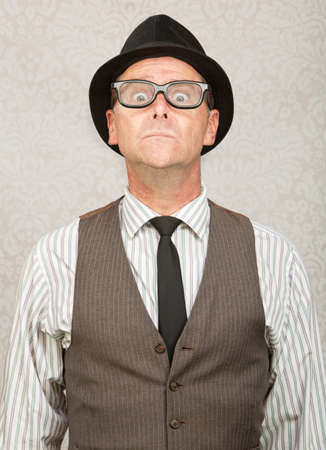 Frightened white businessman with hat and eyeglasses photo