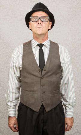 Scared stiff businessman with hat and eyeglasses photo