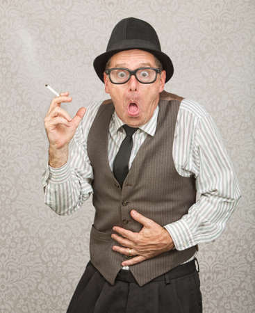 upset stomach: Single man holding cigarette with upset stomach