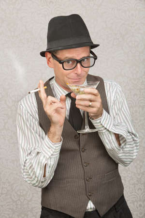 smirking: Smirking businessman with hat and eyeglasses drinking alcohol