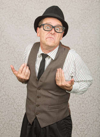 indifferent: Upset white businessman with hat and eyeglasses Stock Photo