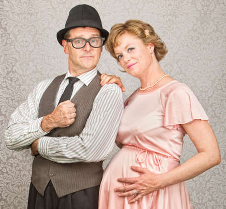 Cute smiling confident pregnant 1950s retro couple Banco de Imagens