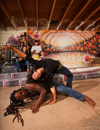 tumbling: Hispanic capoeira experts bending and twisting their bodies