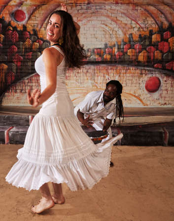 Happy dancing woman with handsome drummer indoors Фото со стока