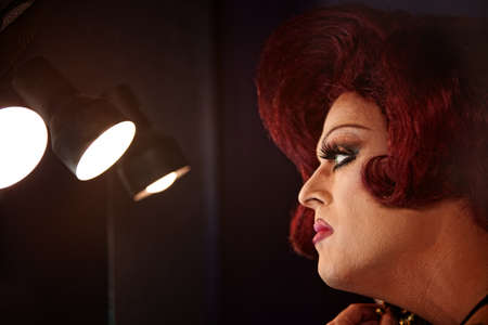 Big beautiful Caucasian drag queen with lights