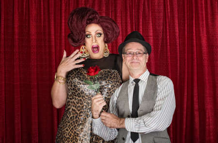 mismatch: Retro man giving surprised drag queen a rose