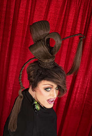 coy: Coy Caucasian drag queen with ponytails in theater